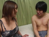 Brave Japanese teen, Ako Ishida, gives a foot job and arranges a kinky action picture 3