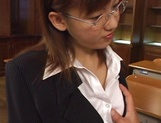 Horny Japanese teacher gives head and provides a hot hand job picture 2