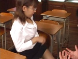Horny Japanese teacher gives head and provides a hot hand job picture 6