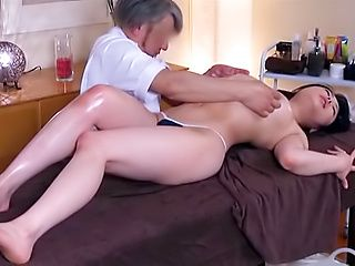 Big tits busty Asian milf enjoys a seductive massage