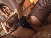 Japanese in fishnet costume gets fucked hard