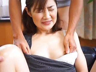 Hot mature Asian babe strokes cock between her hands