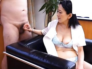 Naughty mature Asian nurse enjoys giving hot handjob at work