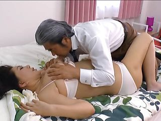 Japanese AV model with big tits gets mature pussy fingered