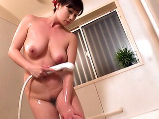 Busty Asian plays with her pussy in the shower