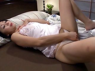 Beautiful Japanese AV model masturbates wet mature pussy