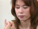 Mature Japanese AV model blows young guys fat dick picture 12