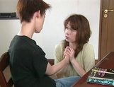 Mature Japanese AV model blows young guys fat dick picture 13