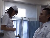 Hot Japanese nurse spreads legs for a huge cock