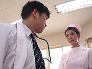 Sexy Asian nurse gives a wicked head before sex