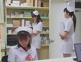 Lesbian nurses enjoying a quick oral together