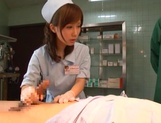 Crazy nurse Minami Kojima gives a hand job and rides cock picture 11