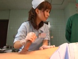 Crazy nurse Minami Kojima gives a hand job and rides cock picture 12