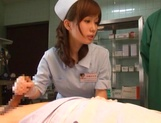 Crazy nurse Minami Kojima gives a hand job and rides cock picture 14