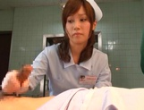 Crazy nurse Minami Kojima gives a hand job and rides cock picture 15