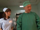 Crazy nurse Minami Kojima gives a hand job and rides cock picture 2