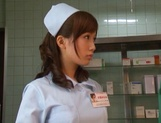 Crazy nurse Minami Kojima gives a hand job and rides cock picture 3