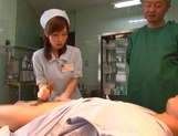 Crazy nurse Minami Kojima gives a hand job and rides cock picture 7