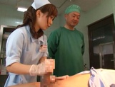 Crazy nurse Minami Kojima gives a hand job and rides cock picture 8