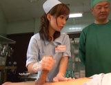 Crazy nurse Minami Kojima gives a hand job and rides cock picture 9