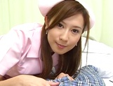 Cute nurse, Hikari Kirishma gives a titfuck and sucks dick for jizz picture 9