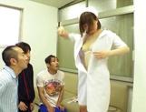 Delicious nurse Koyuru Kanon bonked in a threesome picture 15
