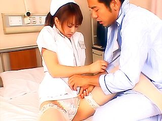 Alluring Japanese AV model plays nurse and gets banged