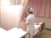 Hot nurse Ria Sakurai in a hardcore sex action gets cum on tits