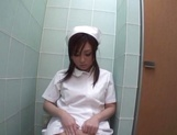 Voluptuous Japanese nurse plays with pussy in the toilet