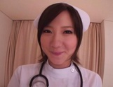 Busty Japanese AV Model is a nurse who loves to fuck in hardcore picture 1