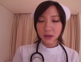 Busty Japanese AV Model is a nurse who loves to fuck in hardcore picture 5