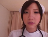 Busty Japanese AV Model is a nurse who loves to fuck in hardcore picture 7