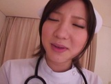 Busty Japanese AV Model is a nurse who loves to fuck in hardcore picture 8