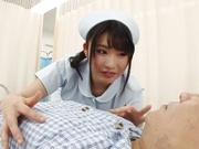 Crazy Japanese nurse in white stockings sits on a face gives a blow