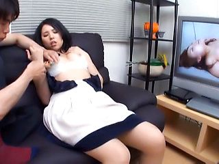 Japanese AV model is a hot milf enjoying pussy stimulation
