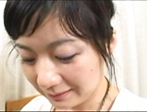 Horny mature Japanese AV Model gets her hairy cunt banged hard picture 2