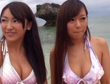 Two kinky Asian girls share cock of a guy and get cum on tits