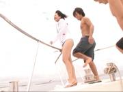 Sweet chick in a blue bikini Nana Nanami fucked by two guys on a boat