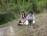 Insolent chick is a horny Japanese AV model giving head outdoors picture 1