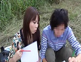Insolent chick is a horny Japanese AV model giving head outdoors picture 3