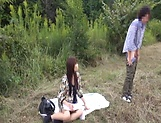 Insolent chick is a horny Japanese AV model giving head outdoors picture 8