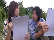 Insolent chick is a horny Japanese AV model giving head outdoors