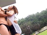 Busty redhead milf enjoys outdoor sex and gets fucked from behind