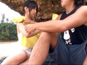Hot Asian babe Nana Nanami sucks dick at the beach