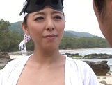 Ryoko Murakami mature Japanese doll gives handjob, gets facial picture 2