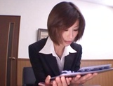 Short-haired office lady Akari Asahina gives her client a blowjob picture 1