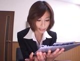 Short-haired office lady Akari Asahina gives her client a blowjob picture 2