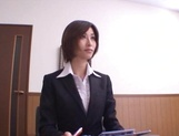 Short-haired office lady Akari Asahina gives her client a blowjob picture 6