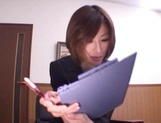 Sizzling Japanese office lady Akari Asahina gives a handjob picture 1