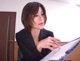 Sizzling Japanese office lady Akari Asahina gives a handjob picture 3